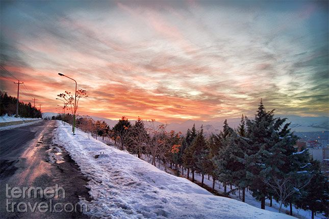 Ardabil, Iran. A stretch of road with snow on its sides, riding into the sunset.