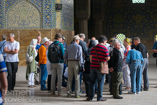 Group of tourists checking out the Shah Mosque in Isfahan
