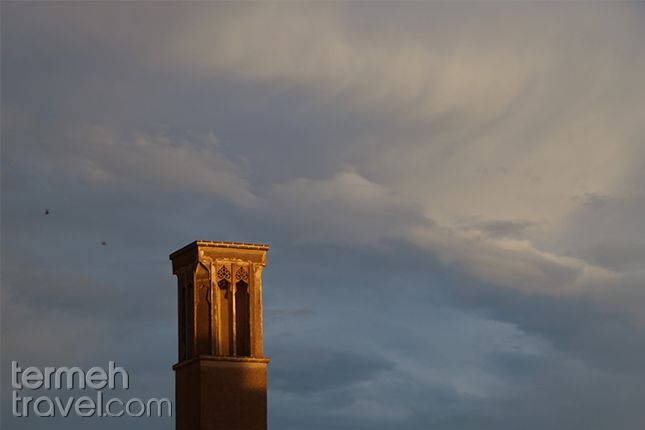 Yazd, Iran. An old windcatcher standing tall in the cloudy sky.