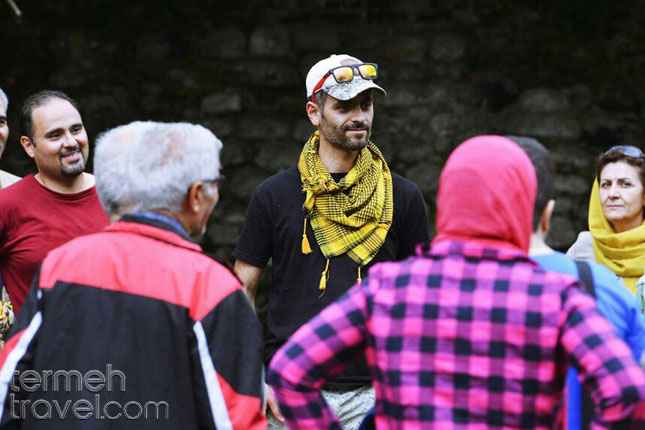 Tour guide speaking to tourists about their trip.