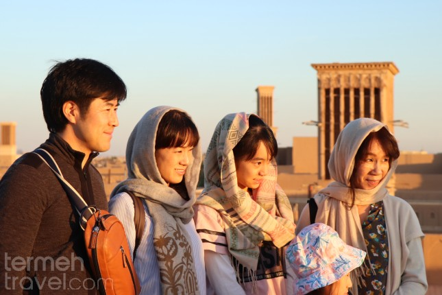 Chinese Tourists Standing on top of Yazd Rooftops, Iran - Termeh Travel