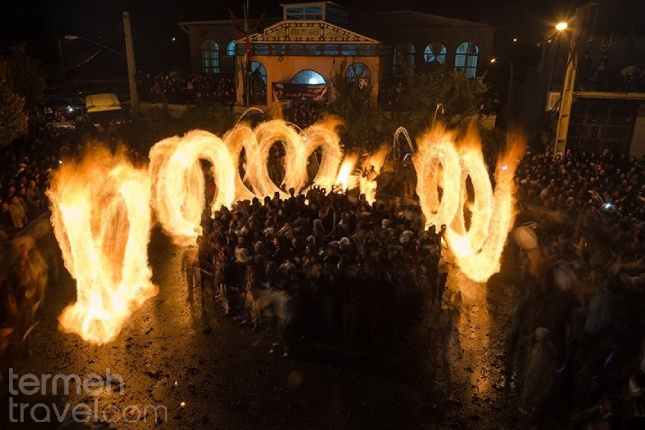 People of Shishvan village lighting giant torches to commemorate the night after Ashura