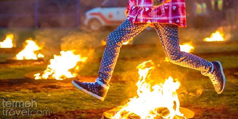 Jumping over fire in Chaharshanbeh Souri- Termeh Travel