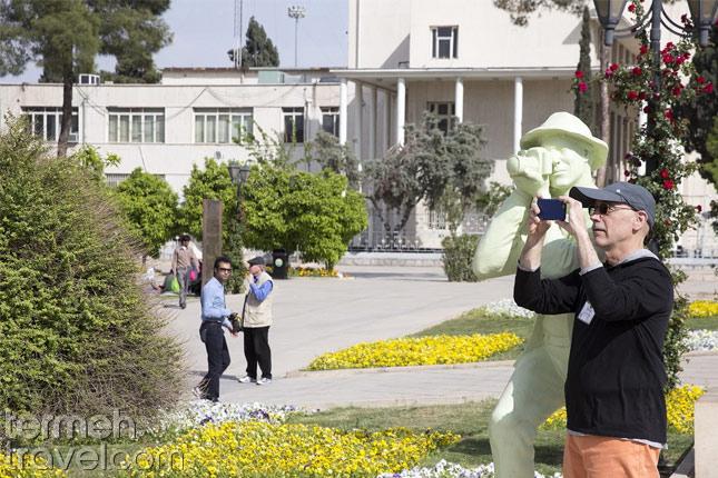 A tourist taking photo of an Iran's tourist spot- Termeh Travel