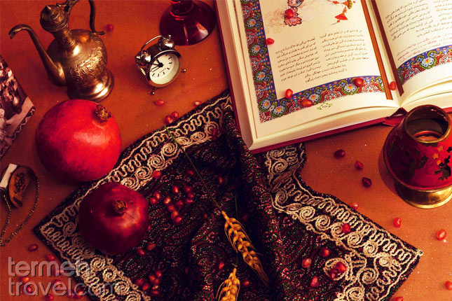 Pomegranate and Hafez poems on a table for Yalda night- Termeh Travel