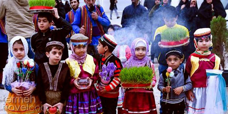 Iranian children wearing traditional clothes and having haft-seen items- Termeh Travel