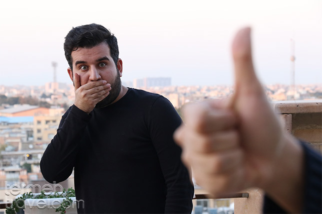 man shocked at someone giving the thumbs-up in Iran, considered rude in the persian culture.