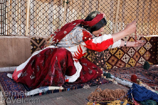 Qashqai nomad woman is weaving a carpet-Nomads of Iran- Termeh Travel