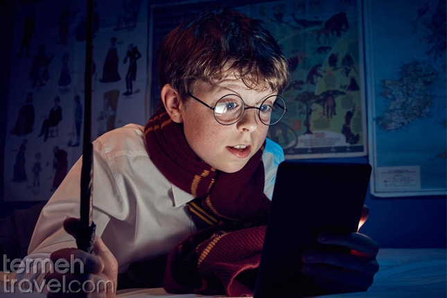 a kid reading Harry Potter-Farsi learning for kids- Termeh Travel
