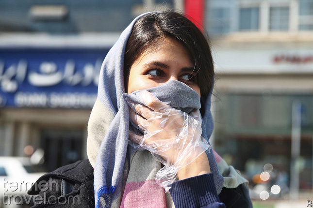 an Iranian female covering her mouth due to the COVID-19- Termeh Travel