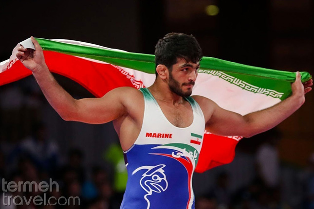 Hassan Yazdani with Iran's flag- Persian Athletes - Termeh Travel